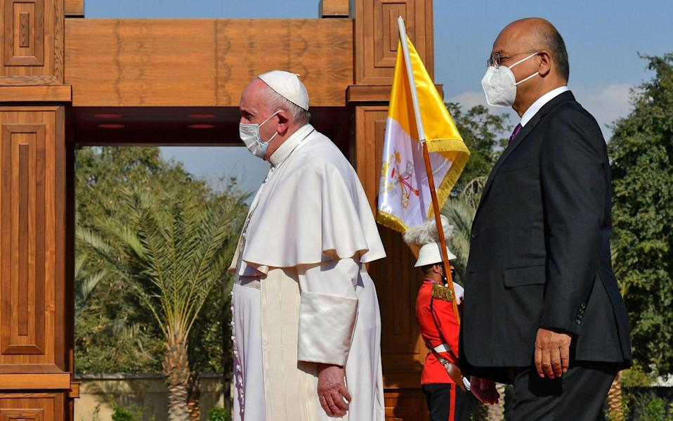Pope Francis is welcomed by Iraqi President Barham Saleh at the presidential palace in Baghdad - Vincenzo Pinto/AFP