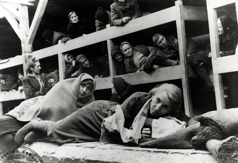 Women in the barracks in Auschwitz, Poland, in January 1945. | Gallery imagery / Getty