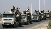 Convoy of Syrian soldiers is seen here outside the city of Hama, in 2011. Government troops using tanks and helicopters on Thursday massacred more than 150 people in the central province of Hama, the Syrian Observatory for Human Rights said, while a rebel leader put the toll at more than 200