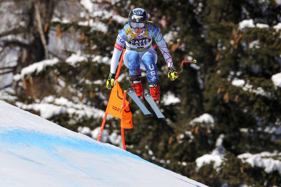United States' Breezy Johnson speeds down the course during the women's downhill, at the alpine ski World Championships in Cortina d'Ampezzo, Italy, Saturday, Feb.13, 2021. (AP Photo/Marco Trovati)