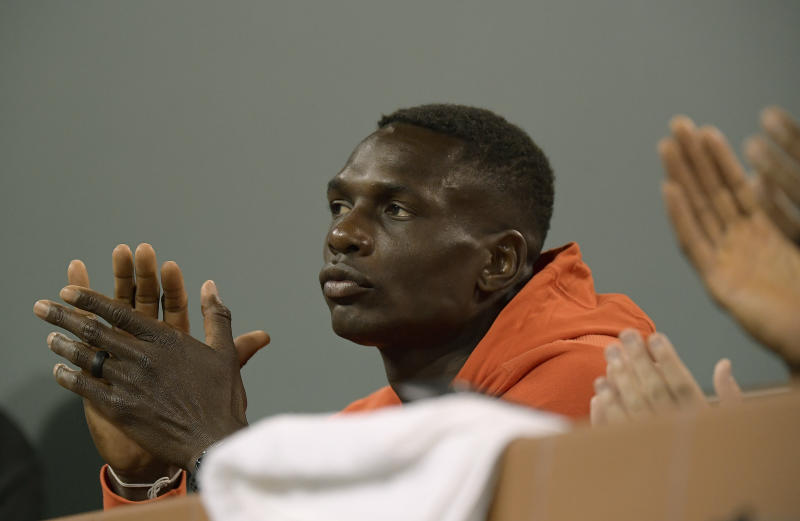 Jermaine Jenkins, coach of Naomi Osaka, of Japan, applauds during her match against Danielle Collins at the BNP Paribas Open tennis tournament Monday, March 11, 2019, in Indian Wells, Calif. (AP Photo/Mark J. Terrill)