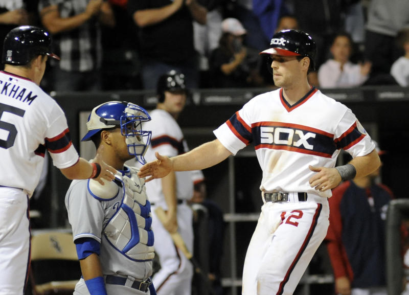 Chicago White Sox's Connor Gillaspie, right, is congratulated by Gordon Beckham after hitting a home run in the seventh inning of a baseball game against the Kansas City Royals on Saturday, Sept. 28, 2013, in Chicago. (AP Photo/Joe Raymond)