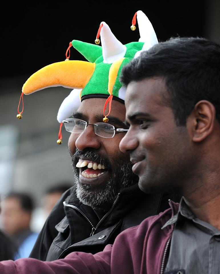 Fans arrive to attend the 2013 ICC Champions Trophy cricket match between Pakistan and India at Edgbaston in Birmingham, central England, on June 15, 2013.  AFP PHOTO/ANDREW YATES