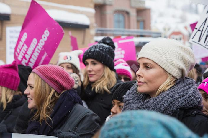 <p>Maria Bello and Charlize Theron participate in the Women's March on Main Street Park City on January 21, 2017 in Park City, Utah. (Mat Hayward/GC Images) </p>