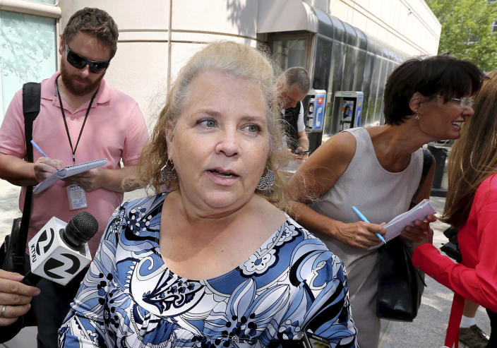 FILE - In this Aug. 23, 2018, file photo Jennifer Carole, the daughter of Lyman Smith, believed to be one of the victims of the Golden State Killer, talks with reporters after Joseph James DeAngelo's court appearance in Sacramento, Calif. Forty years after a sadistic suburban rapist terrorized California in what investigators only later realized were a series of linked assaults and slayings, the 74-year-old former police officer is tentatively set to plead guilty Monday, June 29,2020, to being the elusive Golden State Killer. (AP Photo/Rich Pedroncelli, File)