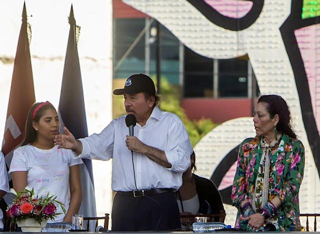 "<p>Nicaraguan President Daniel Ortega (C), next to Vice-President Rosario Murillo (R), gives a speech during a pro-government rally on Nicaragua's National Mothers Day at the ""Rotonda Hugo Chavez"" in Managua on May 30, 2018. (Photo: Inti Ocon/AFP/Getty Images) </p>"