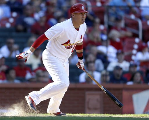 St. Louis Cardinals' Allen Craig watches his game-winning single to score teammate Matt Carpenter during the 10th inning of a baseball game against the Milwaukee Brewers, Sunday, Sept. 9, 2012, in St. Louis. The Cardinals won 5-4. (AP Photo/Jeff Roberson)