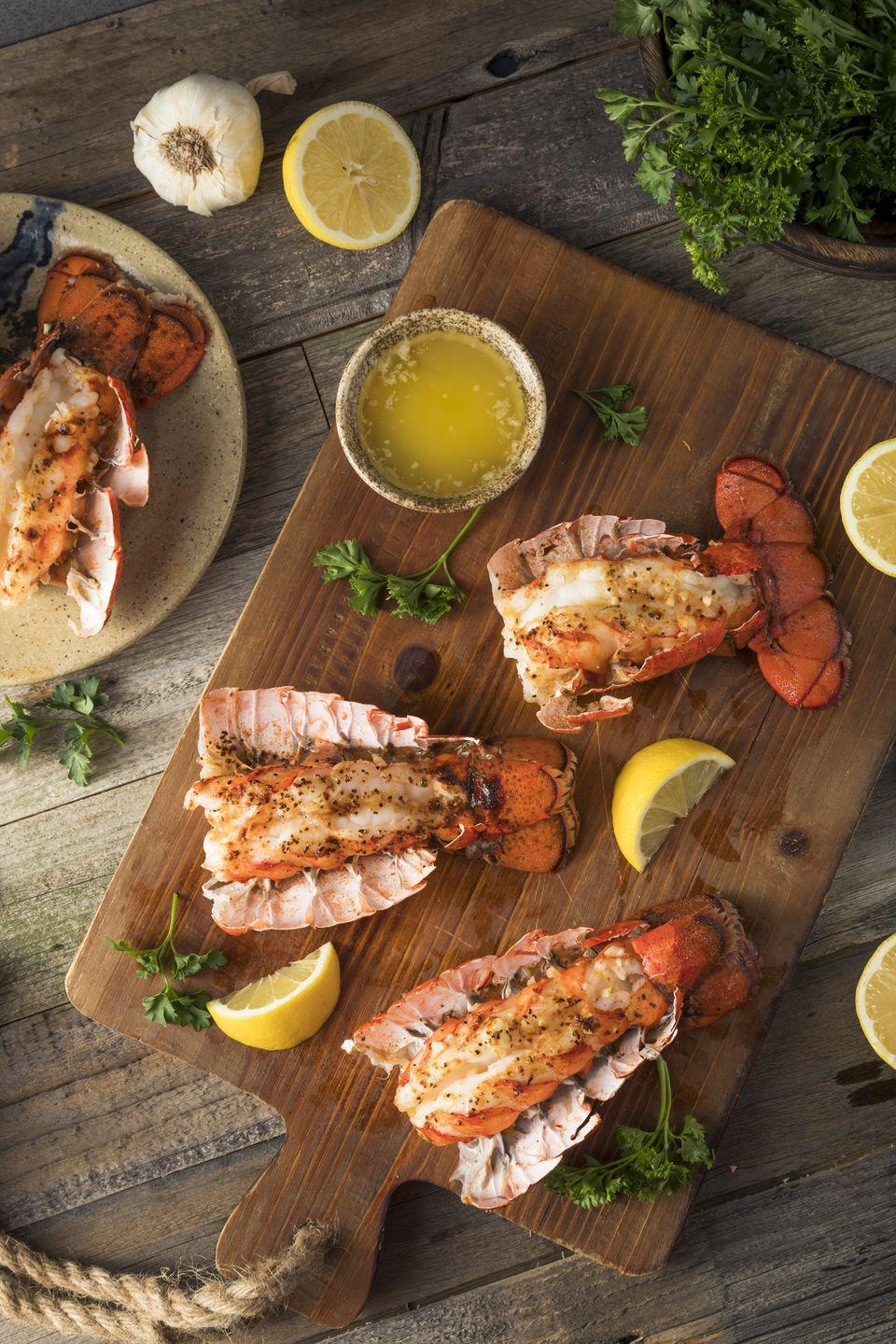 """<p>You may want to rethink any fancy <a href=""""https://www.countryliving.com/food-drinks/recipes/g1078/new-years-food/"""" rel=""""nofollow noopener"""" target=""""_blank"""" data-ylk=""""slk:New Year's Eve food"""" class=""""link rapid-noclick-resp"""">New Year's Eve food</a> ideas that include lobster. Many cultures believe that eating lobsters before midnight is bad luck because they move backwards, therefore setting you up for a year of setbacks. </p>"""