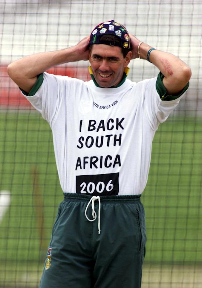 21 May 1999:  Hansie Cronje of South Africa shows his support of the 2006 bid for the world cup soccer during nets practice in preparation for their 3rd World Cup match against England at the Oval,London. Mandatory Credit: Laurence Griffiths/ALLSPORT