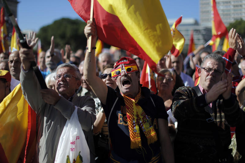 Protestors shout slogans and wave Spanish flags during a demonstration in Madrid, Spain, Sunday, Oct. 27, 2013. Several thousand people have gathered in downtown Madrid to protest the release from jail of Basque separatists who were convicted of attacks but freed under a European Court of Human Rights ruling. The Strasbourg-based court found that prisoners who had served time and completed sentence reduction programs couldn't have their jail terms re-interpreted by Spain's judiciary. (AP Photo/Andres Kudacki)