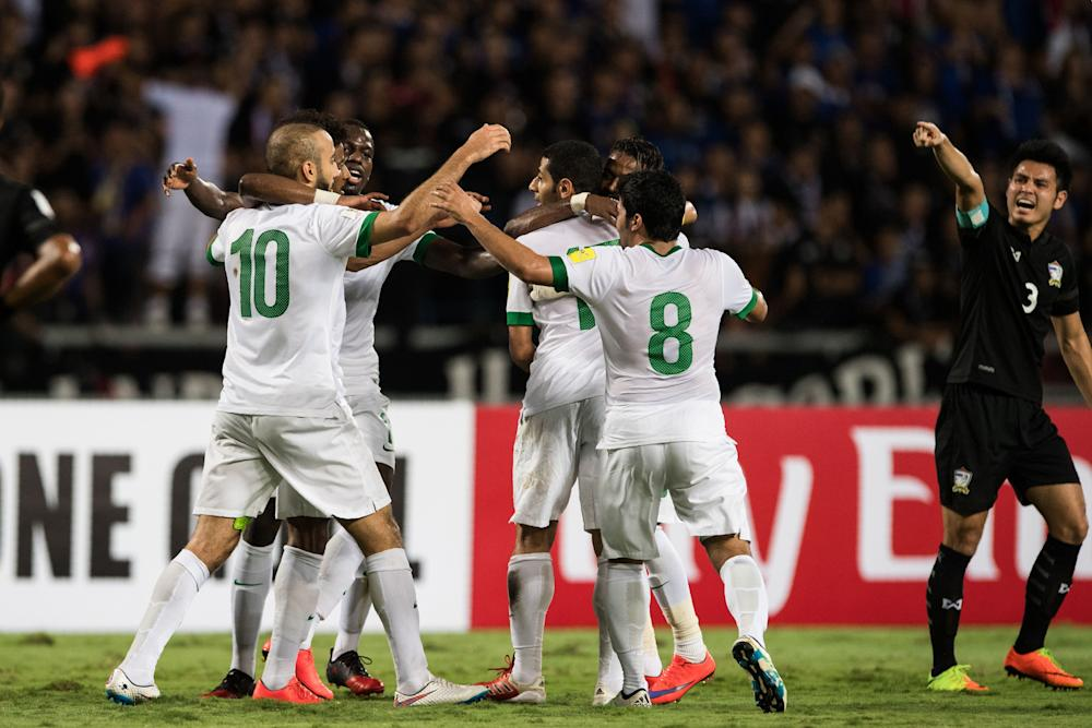 Saudi's Mohammed Al Sahlawi (2nd L) celebrates with teammates following his goal in the first half during the Round 3 Group B 2018 World Cup football qualifying match between Saudi Arabia and Thailand in Bangkok