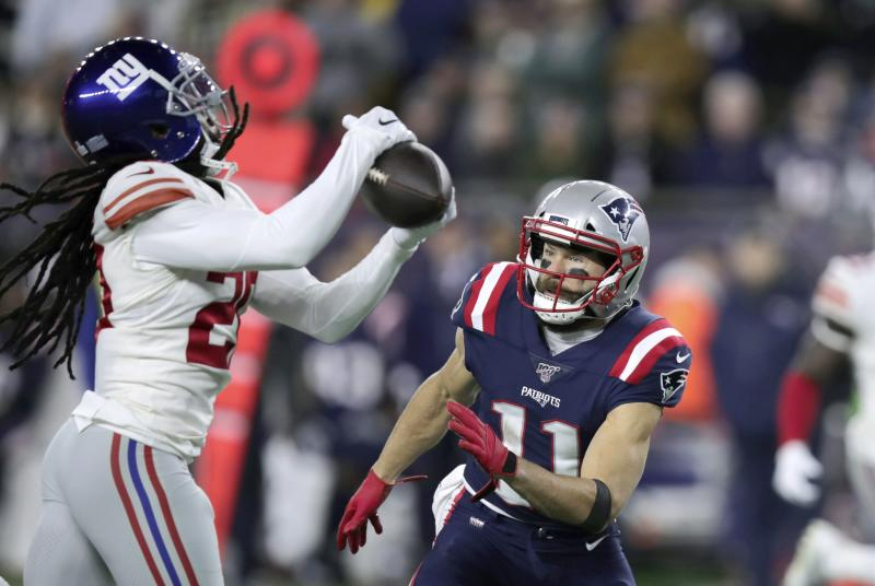 New York Giants cornerback Janoris Jenkins, left, intercepts a pass intended for New England Patriots wide receiver Julian Edelman, right, in the first half of an NFL football game, Thursday, Oct. 10, 2019, in Foxborough, Mass. (AP Photo/Charles Krupa)