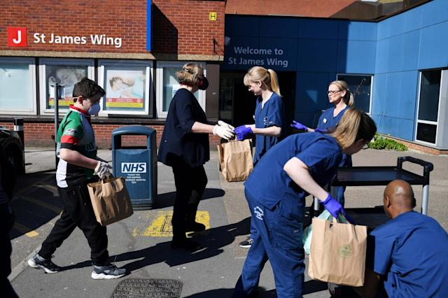 Volunteers deliver food to nurses and staff outside St George's Hospital: REUTERS
