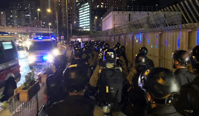 Riot police outside the Yuen Long MTR station on Sunday. Photo: Alvin Lum