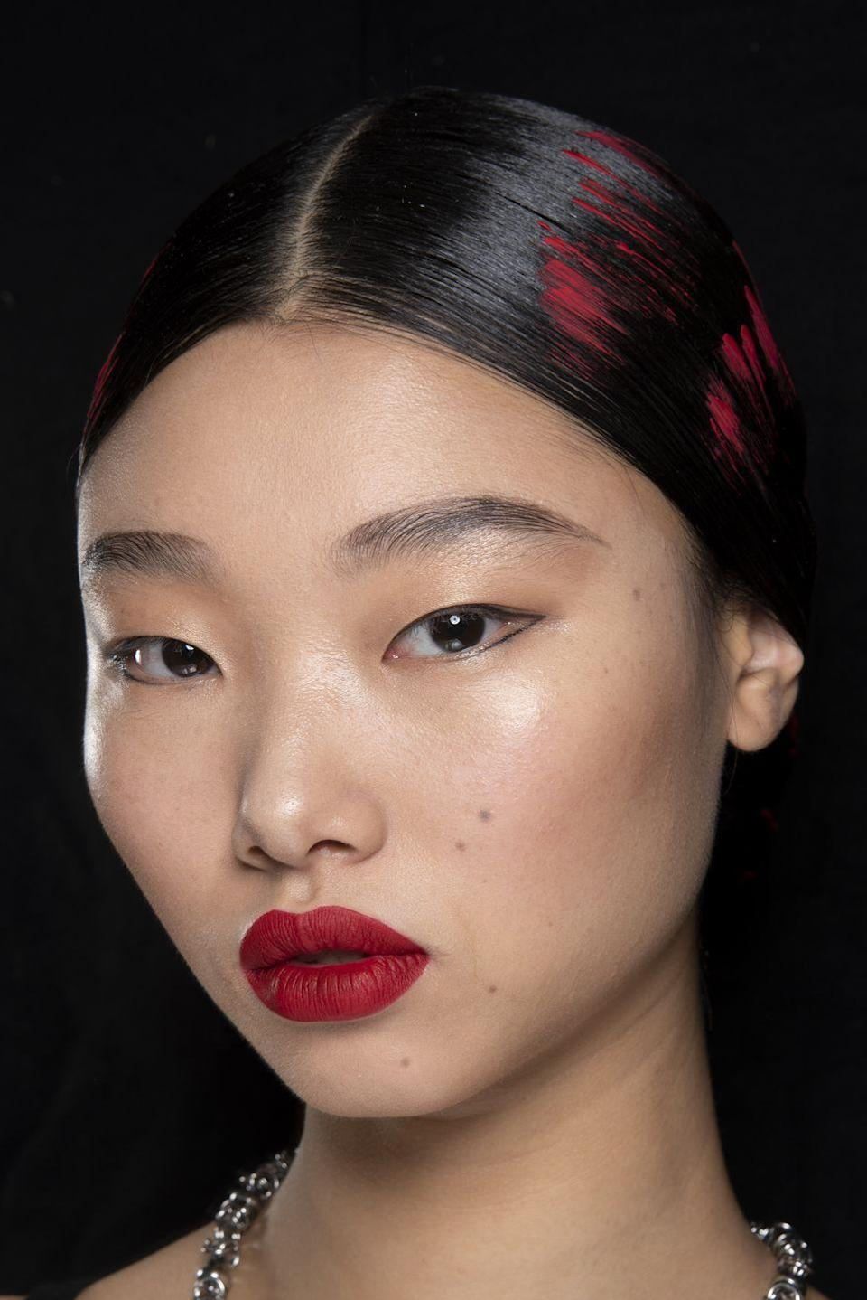<p>A fierce red lip strikes the right note between classic and statement-making. </p>