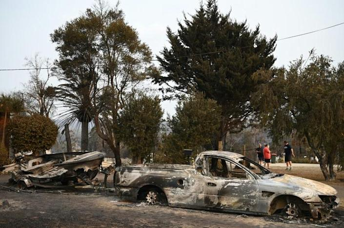 Vehicles and homes have been wrecked by the blazes (AFP Photo/PETER PARKS)