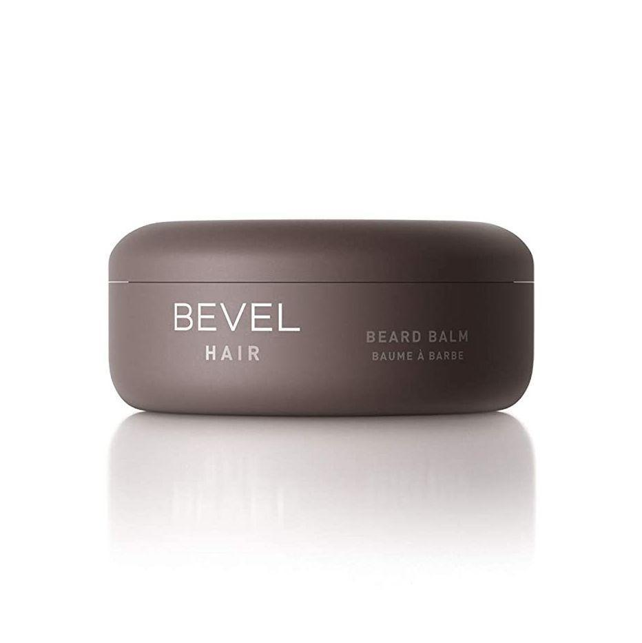 """<p><strong>Bevel</strong></p><p>amazon.com</p><p><strong>$9.93</strong></p><p><a href=""""https://www.amazon.com/dp/B07DHW3DLP?tag=syn-yahoo-20&ascsubtag=%5Bartid%7C2141.g.27288061%5Bsrc%7Cyahoo-us"""" rel=""""nofollow noopener"""" target=""""_blank"""" data-ylk=""""slk:Shop Now"""" class=""""link rapid-noclick-resp"""">Shop Now</a></p><p>Dad should be proud of his beard, but he might not be a fan of how dry or scraggly it can get. (Mom probably disapproves, too.) Fix that problem with this all0natural, ultra-hydrating beard balm from skincare startup Bevel, which locks in moisture without clogging pores.</p>"""