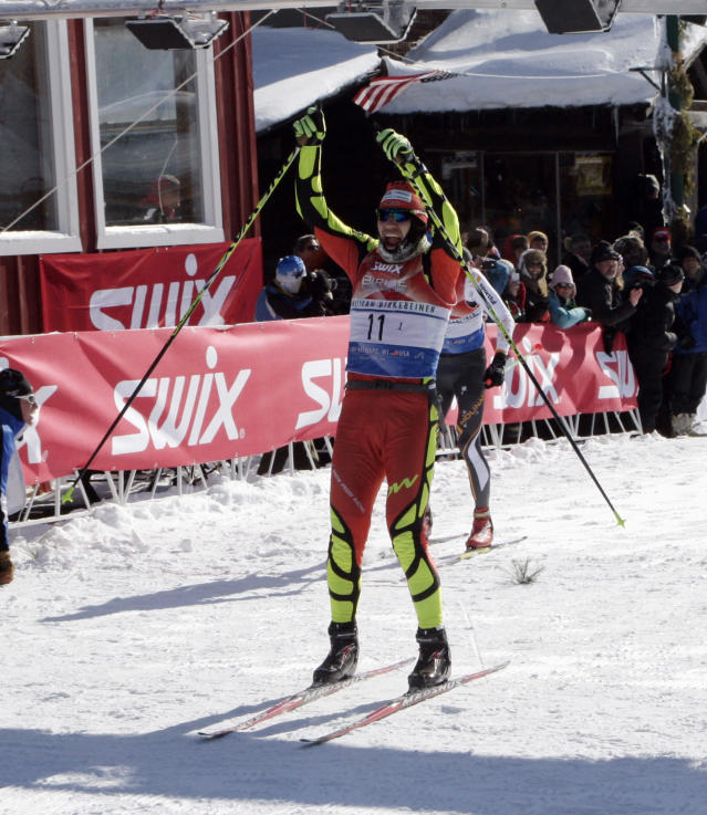 Tom Reichelt, of Oberwiesenthal, Germany, crosses the finish line of the American Birkebeiner, in Hayward, Wis., on Saturday, Feb. 22, 2014. Reichelt had a time of 2:14:29.9. (AP Photo/Paul M. Walsh)