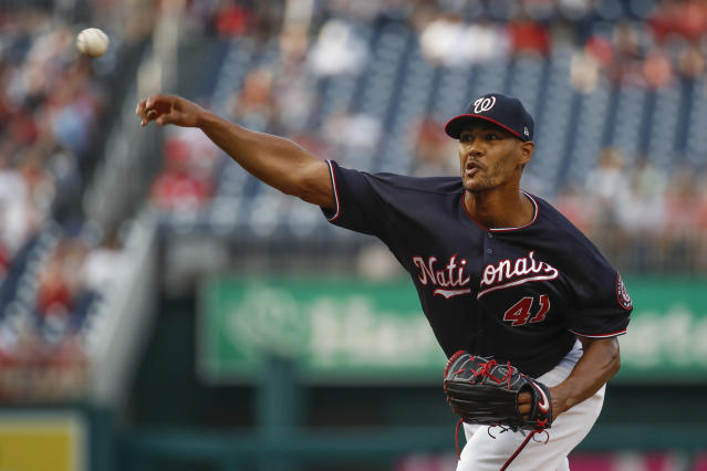 Washington Nationals starting pitcher Joe Ross throws during the first inning of the team's baseball game against the Cincinnati Reds at Nationals Park, Tuesday, Aug. 13, 2019, in Washington. (AP Photo/Alex Brandon)