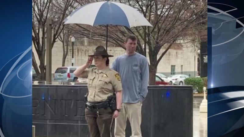 Image result for birmingham man holds umbrella for police officer