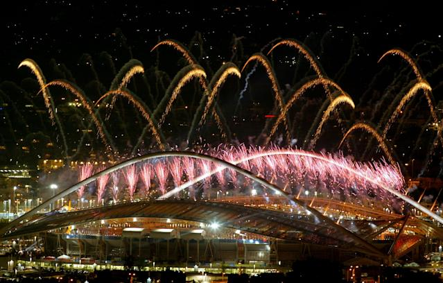 ATHENS - AUGUST 29: Fireworks are seen during the closing ceremonies of the Athens 2004 Summer Olympic Games on August 29, 2004 at the Sports Complex Olympic Stadium in Athens, Greece. The next summer Olympic Games will be held in Beijing in 2008. (Photo by Milos Bicanski/Getty Images)