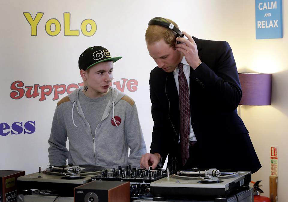 Britain's Prince William (R), Duke of Cambridge, uses a DJ set during a visit to the the Quarriers Stopover Project in Glasgow, Scotland on April 4, 2013. The Duke and Duchess of Cambridge, known as the Earl and Countess of Strathearn in Scotland,  visted the  Quarriers Stopover, which is a short-term residential unit for 14 young people aged between 16 and 25 who find themselves homeless.  AFP PHOTO / POOL / DANNY LAWSON        (Photo credit should read DANNY LAWSON/AFP via Getty Images)