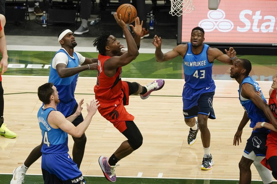 Toronto Raptors' OG Anunoby shoots in traffic during the second half of an NBA basketball game against the Milwaukee Bucks Thursday, Feb. 18, 2021, in Milwaukee. (AP Photo/Morry Gash)