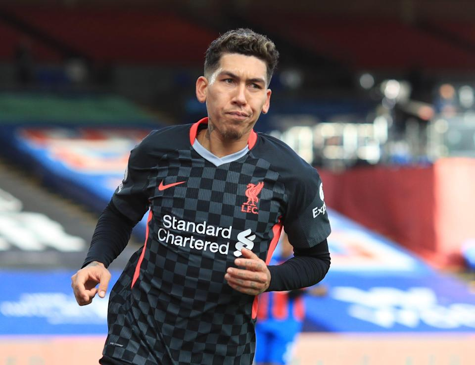 Roberto Fermino celebrates his second scoring celebration in Liverpool and the 7–0 demolition of Crystal Palace (EPA);