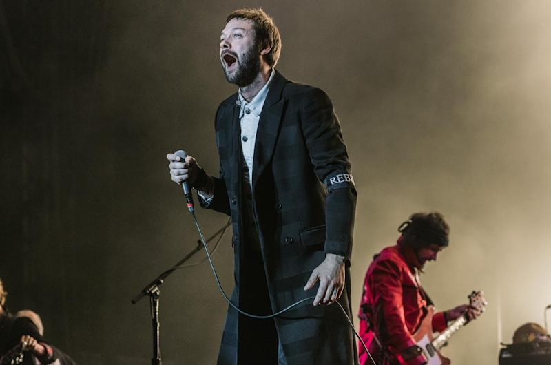 Tom Meighan from Kasabian performs at Reading Festival 2017: Getty