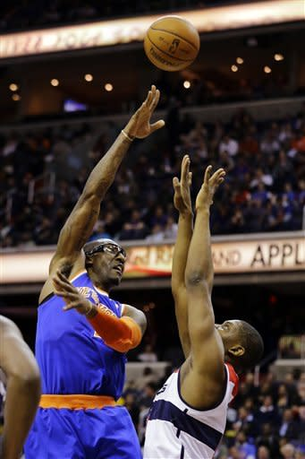 New York Knicks forward Amare Stoudemire (1) shoots over Washington Wizards forward Kevin Seraphin (13), of France, in the first half of an NBA basketball game, Wednesday, Feb. 6, 2013, in Washington. (AP Photo/Alex Brandon)
