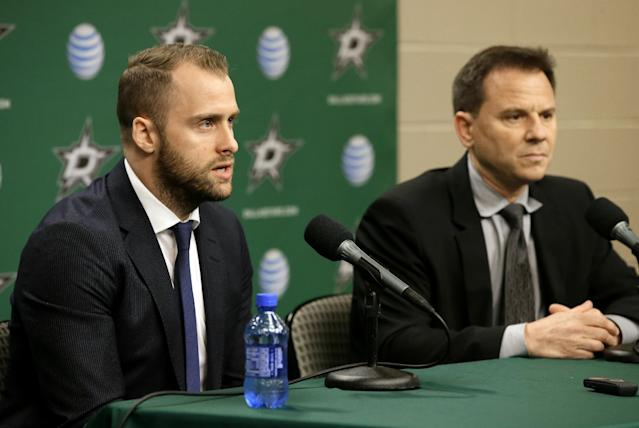 Dallas Stars center Rich Peverley, left, responds to questions during a news conference as team physician Dr. Robert Dimeff, right, watches before an NHL hockey game against the Nashville Predators, Friday, March 28, 2014, in Dallas. Peverley collapsed on the bench during a game earlier this month. He then had surgery to correct an abnormal heart rhythm. (AP Photo/Tony Gutierrez)