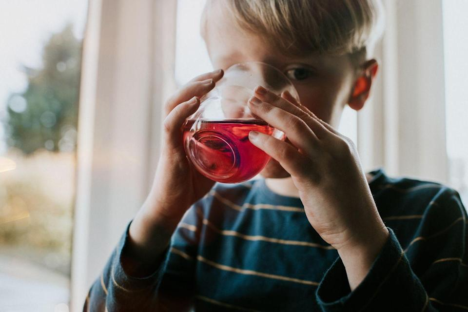 """<p>Fruit juice is almost always marketed towards kids, and again, it seems healthy because it has the word """"fruit"""" in it. But just like with fruit snacks, fruit juice is loaded with sugar. The <a href=""""https://www.healthychildren.org/English/news/Pages/AAP-Recommends-No-Fruit-Juice-for-Children-Under-1-Year.aspx"""" rel=""""nofollow noopener"""" target=""""_blank"""" data-ylk=""""slk:American Academy of Pediatrics"""" class=""""link rapid-noclick-resp"""">American Academy of Pediatrics</a> recommends no fruit juice to kids under 1, because it contains zero nutritional benefits for this age group. Toddlers ages 1-3 should only have four ounces daily, for 4-6 only 4 to 6 ounces daily, and for ages 7-18, only 8 ounces daily. They also recommend not giving toddlers juice in sippy cups that allow them to have it throughout the day since it can lead to tooth decay.</p><p>Your best bet is avoiding fruit juice as much as possible and offering water, milk, or water flavored with real fruit.</p>"""
