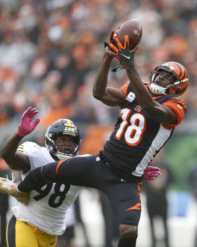 FILE - In this Sunday, Oct. 14, 2018, file phot,o, Cincinnati Bengals wide receiver A.J. Green (18) catches a pass against Pittsburgh Steelers linebacker Vince Williams (98) in the first half of an NFL football game in Cincinnati. It's been a while since the NFL flexed a game to Sunday night. The Bengals vs. Chiefs is a worthy choice(AP Photo/Gary Landers)