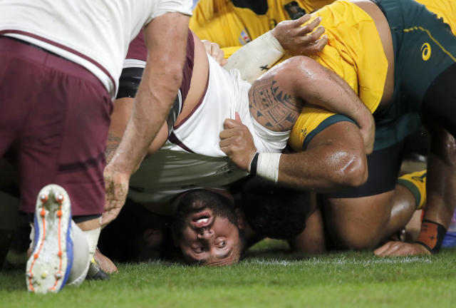 Georgia's Beka Gigashvili reacts as a scrum collapses to the ground during the Rugby World Cup Pool D game at Shizuoka Stadium Ecopa between Australia and Georgia in Shizuoka, Japan, Friday, Oct.11, 2019. (AP Photo/Christophe Ena)