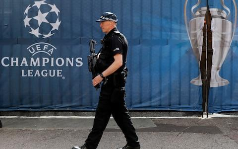 An armed police officer guards outside the Millennium Stadium in Cardiff, Wales, ahead of the Champions League final - Credit: AP