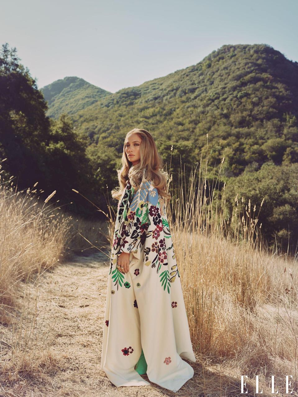 <p>J Lo wears a Valentino cape with Cartier rings and Brother Vellies boots.</p>