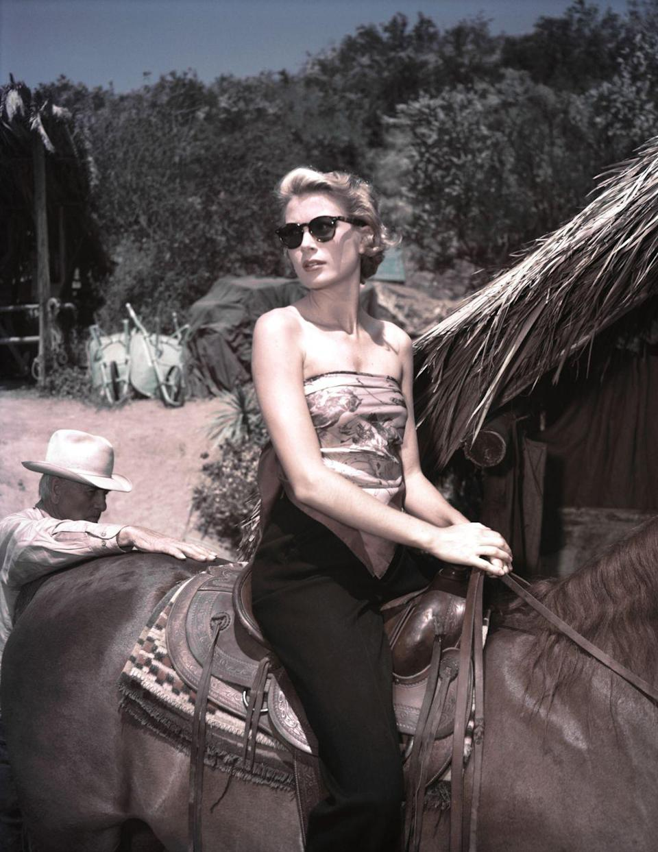 <p>Kelly rides horseback on location in Equatorial Africa in 1953 for her film, <em>Mogambo. </em>The picture earned her an Academy Award nomination for best supporting actress. </p>