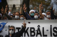 Demonstrators chant slogans during an anti-France protest in Istanbul, Sunday, Oct. 25, 2020. Turkish President Recep Tayyip Erdogan on Sunday challenged the United States to impose sanctions against his country while also launching a second attack on French President Emmanuel Macron. Speaking a day after he suggested Macron needed mental health treatment because of his attitude to Islam and Muslims, which prompted France to recall its ambassador to Ankara, Erdogan took aim at foreign critics. (AP Photo/Emrah Gurel)