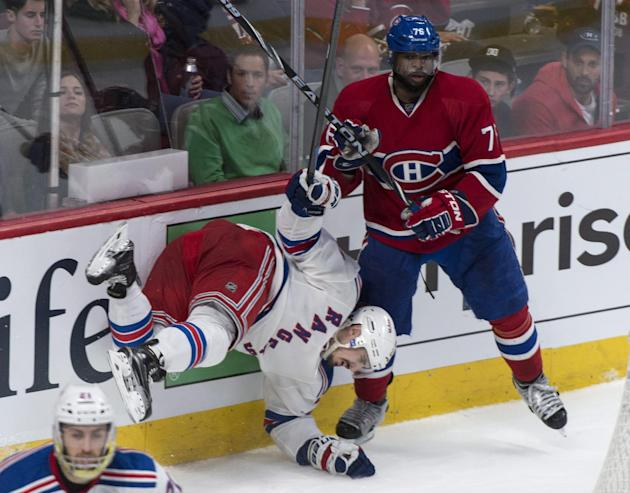 New York Rangers' Chris Kreider falls in front of Montreal Canadiens' P.K. Subban during the third period of Game 5 of the NHL hockey Stanley Cup playoffs Eastern Conference finals, Tuesday, May 27, 2014, in Montreal. Montreal won 7-4. (AP Photo/The Canadian Press, Paul Chiasson)