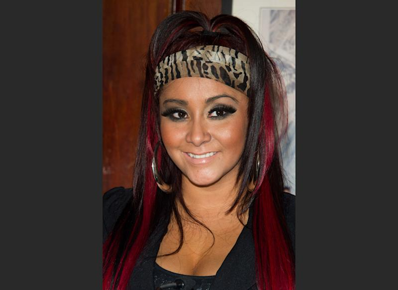 """FILE - In this Thursday, Jan. 12, 2012 file photo, Nicole """"Snooki"""" Polizzi attends a media event to announce her new venture, Team Snooki Boxing and the upcoming boxing matches featuring Ireland's Hyland brothers, in New York. Some residents of the Jersey shore town of Berkeley Township, N.J., say they don't want reality star Polizzi to benefit from efforts to rebuild from Superstorm Sandy. Town residents and officials say Polizzi plans to vacation and film in a house in the Pelican Island neighborhood for the new season of her """"Jersey Shore"""" spinoff, """"Snooki and JWoww."""" (AP Photo/Charles Sykes, File)"""
