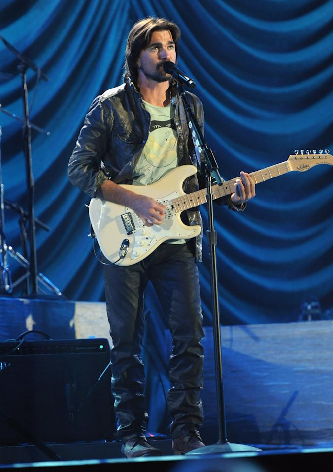 "LOS ANGELES, CA - OCTOBER 15:  (CALL FOR IMAGE, NO ARCHIVE, FOR EDITORIAL USE OF STORIES RELATED TO A DECADE OF DIFFERENCE: A CONCERT CELEBRATING 10 YEARS OF THE WILLIAM J. CLINTON FOUNDATION ONLY)  In this handout image provided by Getty Images, Juanes performs at ""A Decade of Difference:  A Concert Celebrating 10 Years of the William J. Clinton Foundation."" The star-studded affair, a charitable event organized to raise awareness around Clinton Foundation's efforts to improve global health, strengthen economies worldwide, promote healthier childhoods, and protect the environment, was held at the iconic Hollywood Bowl on October 15, 2011 in Los Angeles, California.  (Photo by Handout/Getty Images for Control Room)"