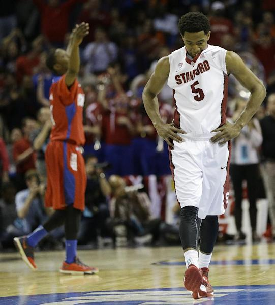 Stanford guard Chasson Randle (5) walks off the court after the second half in a regional semifinal game against Dayton at the NCAA college basketball tournament, Thursday, March 27, 2014, in Memphis, Tenn. Dayton won 82-72. (AP Photo/Mark Humphrey)