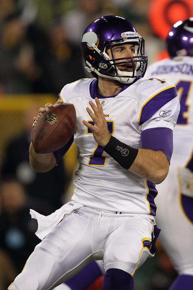 GREEN BAY, WI - NOVEMBER 14:  Christian Ponder #7 of the Minnesota Vikings throws a pass against the Green Bay Packersat Lambeau Field on November 14, 2011 in Green Bay, Wisconsin.  (Photo by Jonathan Daniel/Getty Images)