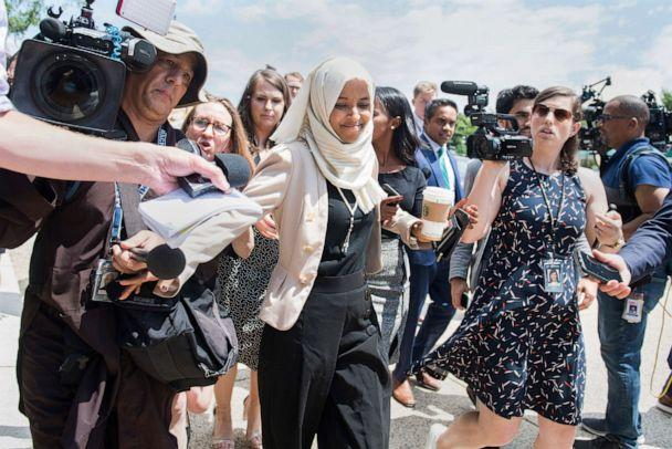 PHOTO: Rep. Ilhan Omar responds to reporters questions after a vote in the Capitol, about derogatory comments made by President Trump about her and other freshmen members, July 18, 2019. (Tom Williams/CQ-Roll Call via Getty Images)