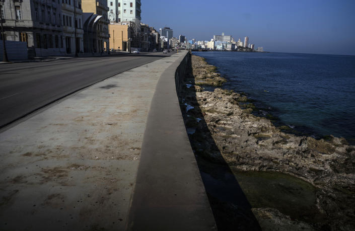 A view of the malecon completely empty of tourists in Havana, Cuba, March 2, 2021. The Caribbean is hunting for visitors to jump-start the stalled economy in one of the world's most tourism-dependent regions (AP Photo/Ramon Espinosa)