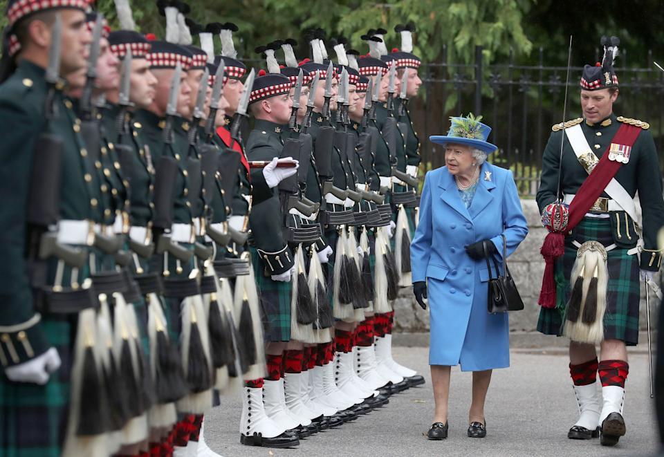 Queen Elizabeth II, with Officer Commanding Major Johnny Thompson, inspects Balaclava Company, 5 Battalion The Royal Regiment of Scotland at the gates at Balmoral, as she takes up summer residence at the castle. (Photo by Andrew Milligan/PA Images via Getty Images)