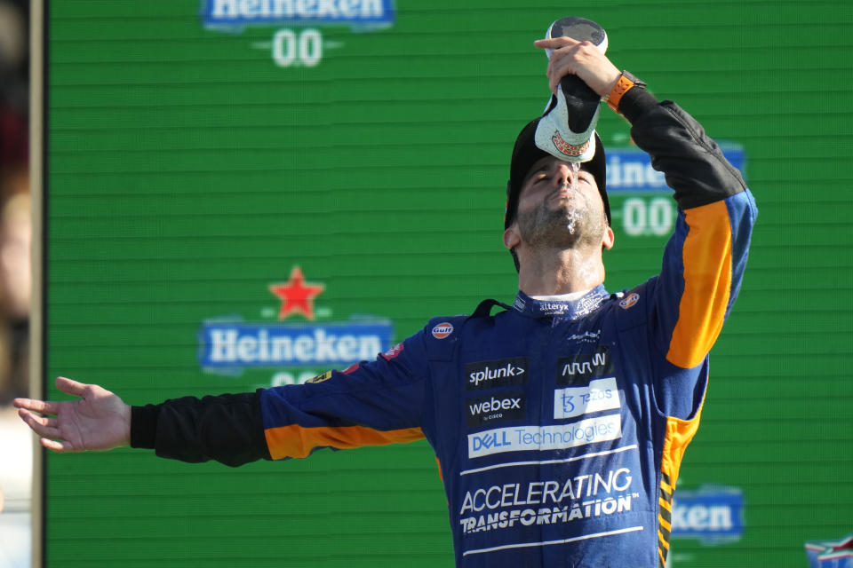 Mclaren driver Daniel Ricciardo of Australia drinks champagne from his shoe as he celebrates after winning the Italian Formula One Grand Prix, at Monza racetrack, in Monza, Italy, Sunday, Sept.12, 2021. (AP Photo/Luca Bruno)
