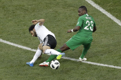 Saudi Arabia's Motaz Hawsawi , right, and Egypt's Mohamed Salah battle for the ball during the group A match between Saudi Arabia and Egypt at the 2018 soccer World Cup at the Volgograd Arena in Volgograd, Russia, Monday, June 25, 2018. (AP Photo/Themba Hadebe)