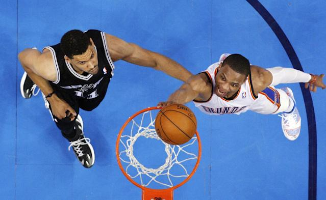 Oklahoma City Thunder guard Russell Westbrook, right, shoots in front of San Antonio Spurs forward Jeff Ayres (11) in the fourth quarter of Game 3 of an NBA basketball playoff series in the Western Conference finals, Sunday, May 25, 2014, in Oklahoma City. Oklahoma City won 106-97. (AP Photo/Sue Ogrocki)