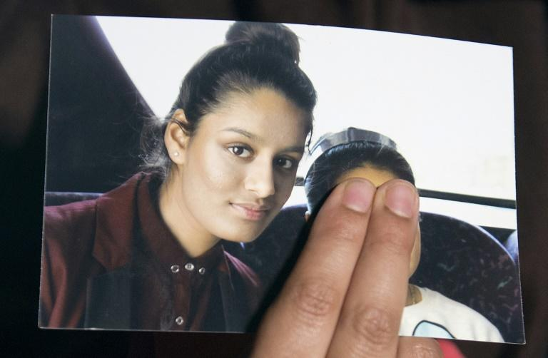 Renu Begum, eldest sister of missing British girl Shamima Begum, holds up a picture of her sister who is at the centre of a moral dilemma for Britain